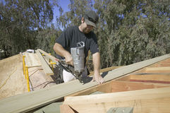Carpenter nailing. Tongue & groove board on roof on new house construction, Ojai, California Royalty Free Stock Photography