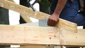 Carpenter Nailing Roof Truss stock footage