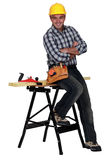 Carpenter next to a workbench Royalty Free Stock Images