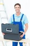 Carpenter opening tool box at table Royalty Free Stock Photography