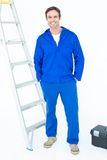 Carpenter in overalls standing with hands in pockets Stock Photos