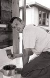Carpenter with paintbrush and bucket Royalty Free Stock Photography
