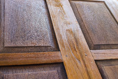 The carpenter is painted beautiful wood doors. Royalty Free Stock Photography