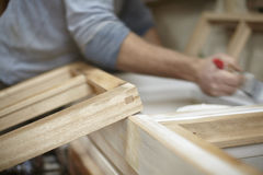 Carpenter painting Newly Made Windows Royalty Free Stock Photo