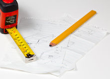 Carpenter pencil and rule on plans Royalty Free Stock Images