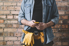 Carpenter on the phone Stock Photography