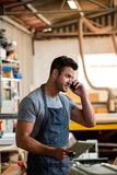 Carpenter on the phone Royalty Free Stock Photography