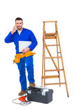 Carpenter on the phone. On white background Stock Photography