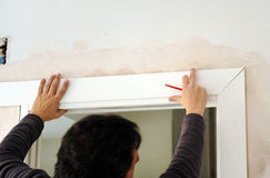 Carpenter placing the flashing white wooden in the door Royalty Free Stock Image