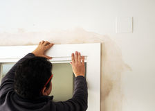 Carpenter placing the flashing white wooden in the door Stock Images