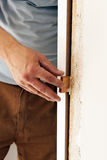 Carpenter placing a new door in the reform of the house Royalty Free Stock Image
