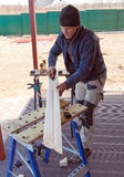 Carpenter with Plane Outdoor Royalty Free Stock Image