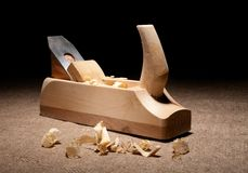 Carpenter plane with shavings Stock Photos
