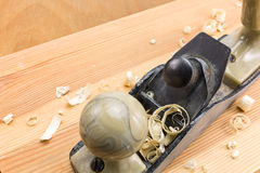 Carpenter plane with shavings Stock Photography