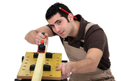 A carpenter with a plane. Royalty Free Stock Photography
