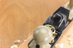 Carpenter plane and wood shavings Stock Photos