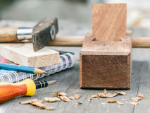 The carpenter plane and wood shavings Stock Photos