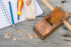 The carpenter plane and wood shavings Royalty Free Stock Images