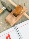 The carpenter plane and wood shavings Stock Photo