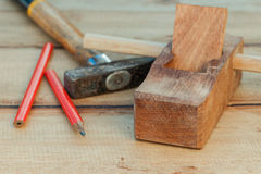 The carpenter plane and wood shavings Stock Image