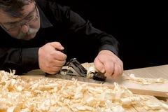 Carpenter planed board using planer Stock Image