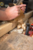 Carpenter with planer Stock Image
