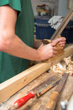 Carpenter with planer Royalty Free Stock Photo