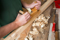 Carpenter with planer Royalty Free Stock Image