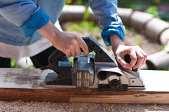 Carpenter with  planes Royalty Free Stock Photo