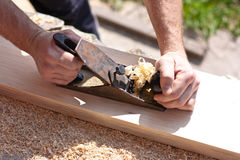 Carpenter with  planes Royalty Free Stock Image