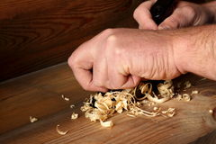 Carpenter planing wood 2 Stock Photos
