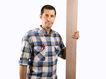 Carpenter with plank Stock Images