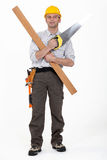 Carpenter with plank and saw Stock Photos