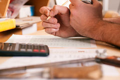 Carpenter planning his work. Man (only hands to be seen) working with set of tools, pencil, calculator and blueprint Royalty Free Stock Photos