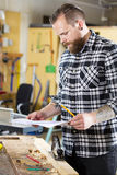 Carpenter planning work and looking at drawings in the workshop Royalty Free Stock Photography