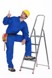 Carpenter pointing upwards Stock Photo
