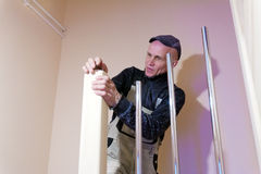 Carpenter Polishing Modern Ladder with Sandpaper Royalty Free Stock Photos