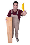 Carpenter posing with floorboards Stock Photography