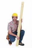 Carpenter posing with timber Royalty Free Stock Photos