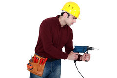 Carpenter with power drill Stock Photos