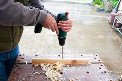 Carpenter power drilling wood Stock Photos