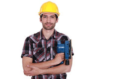 Carpenter with power sander Royalty Free Stock Image