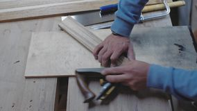 A carpenter processes a wooden blank at an angle with a planer. A woodworker works with a planer. 4k. 4k video. Slow motion. 24. Fps stock video footage