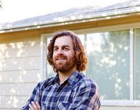 Carpenter profile. Profile of carpenter with arms folded royalty free stock photography