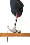 Carpenter pulls a nail. Royalty Free Stock Images