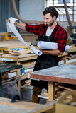 Carpenter reading plans Royalty Free Stock Images