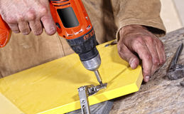Carpenter with red drill stock photography