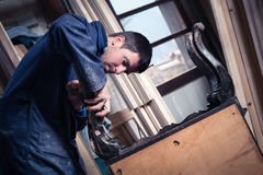 Carpenter restoring Wooden Furniture Stock Photo
