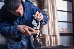 Carpenter restoring Wooden Furniture Stock Images