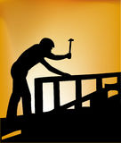Carpenter on roof. Vector silhouette of the carpenter on the roof with hammer royalty free illustration